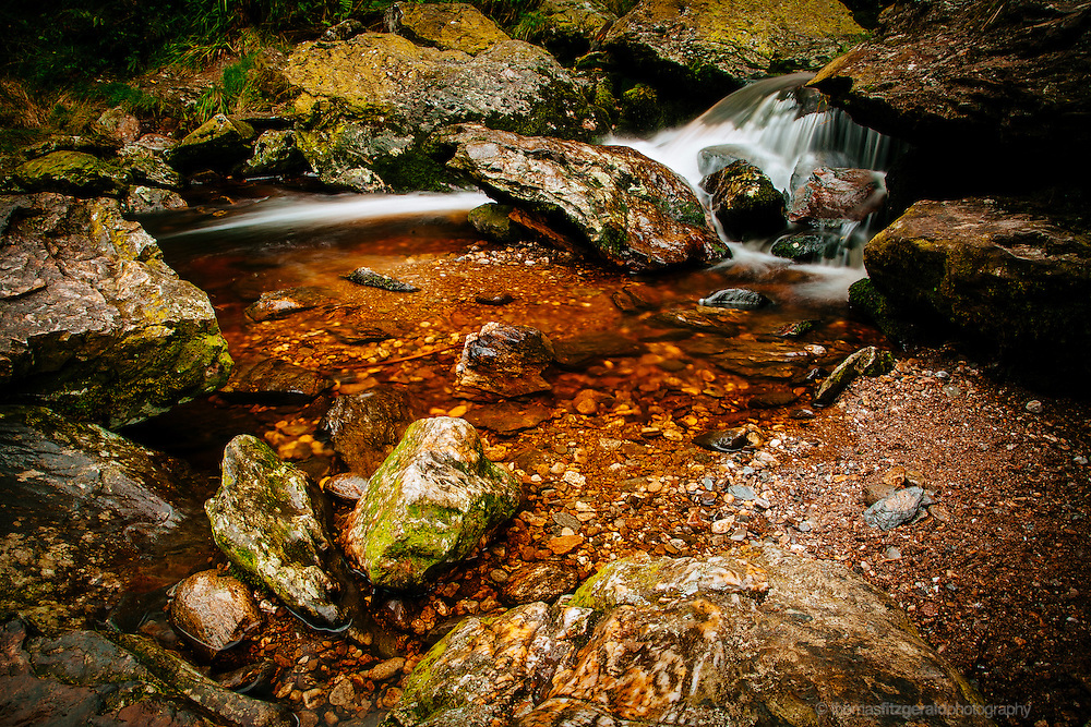 A Copper Coloured Stream flows among the rocks in this mountain river, high in the mountains of Co. Wicklow, Ireland