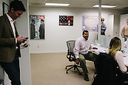 Raj Shah, right of center, and other employees of America Rising attend a daily morning meeting at the office in Rosslyn, Va. America Rising is a conservative political action committee out of Rosslyn, Va. that was started in April by Republican operatives Tim Miller, left, Joe Pounder and Matt Rhoades.