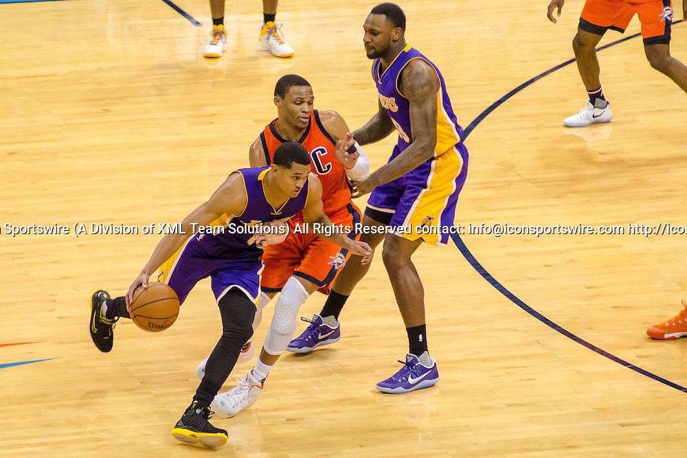 OKLAHOMA CITY, OK - OCTOBER 30: Los Angeles Lakers Guard Jordan Clarkson (6) dribbles around as Oklahoma City Thunder Guard Russell Westbrook (0) fights through the pick.   October 30, 2016, at the Chesapeake Energy Arena Oklahoma City, OK. (Photo by Torrey Purvey/Icon Sportswire)