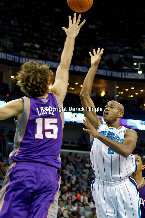 December 30, 2011; New Orleans, LA, USA; New Orleans Hornets point guard Jarrett Jack (2) shoots over Phoenix Suns center Robin Lopez (15) during the first quarter of a game at the New Orleans Arena.   Mandatory Credit: Derick E. Hingle-US PRESSWIRE