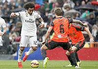 Real Madrid's Marcelo Vieira (l) and Real Sociedad's Inigo Martinez during La Liga match.January 31,2015. (ALTERPHOTOS/Acero)