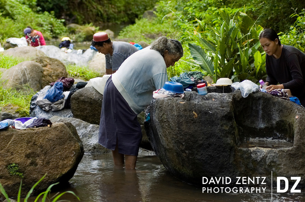 Women wash their laundry in a stream in a remote area of the rural Carazo region of Nicaragua on October 1, 2004. Many homes in the region do not have running water.