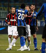 "David Beckham (Milan) argues with Sulley Muntari (Inter).Lite Muntari Beckham.Milano 15/2/2009 Stadio ""Giuseppe Meazza"".Campionato Italiano Serie A.Inter Milan"