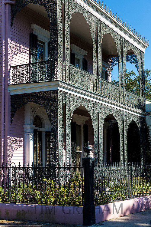 Grand mansion house, ornate lacy iron balcony and double gallery in the Garden District, New Orleans, Louisiana, USA