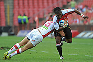JOHANNESBURG, South Africa, 02 April 2011. Bandise Maku of the Lions is tackled by Mike Harris of the Reds during the Super15 Rugby match between the Lions and the Reds at Coca-Cola Park in Johannesburg, South Africa on 02 April 2011. .Photographer : Anton de Villiers / SPORTZPICS
