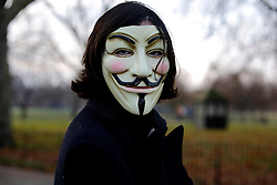 UK ENGLAND LONDON 11DEC10 - A supporter of Wikileaks wearing a Guy Fawkes mask participates in a demonstration at Speakers Corner in Hyde Park demanding the release of its founder Julian Assange...Assange was arrested in London by the Metropolitan Police Service on 7 December by appointment, after a voluntary meeting with the police. Later that day, Assange was refused bail and held in custody on remand...The Guy Fawkes mask is a symbol of the amorphous, leaderless group of internet activists (hactivists) who call themselves Anonymous. In recent weeks Anonymous has sought revenge against some of the world's largest internet companies such as Amazon, Paypal, Visa and Mastercard, temporarily bringing down their websites in retaliation for the dropping of their support for Wikileaks...jre/Photo by Jiri Rezac..© Jiri Rezac 2010