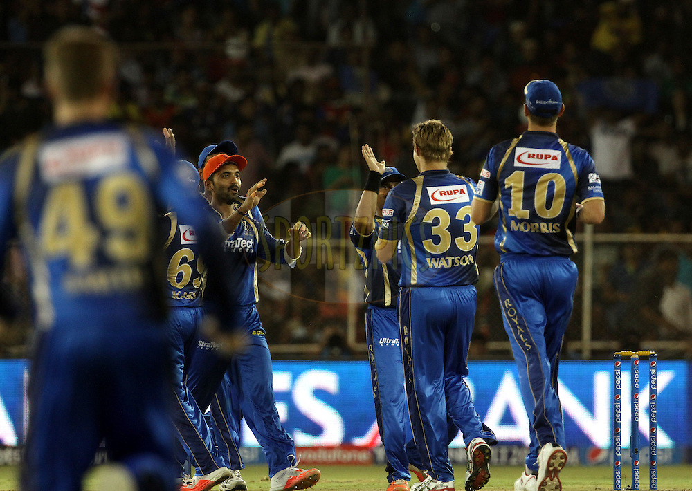 Rajasthan Royals celebrates the wicket Royal Challengers Bangalore player Chris Gayle during match 22 of the Pepsi IPL 2015 (Indian Premier League) between The Rajasthan Royals and The Royal Challengers Bangalore held at the Sardar Patel Stadium in Ahmedabad , India on the 24th April 2015.<br /> <br /> Photo by:  Vipin Pawar / SPORTZPICS / IPL