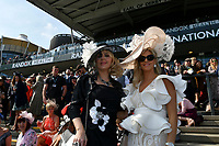National Hunt Horse Racing - 2019 Randox Health Grand National Festival - Saturday, Day Three (Grand National Day)<br /> <br /> female racegoers in hats  in the sunshine before  the 1.45 Gaskells Handicap Hurdle (Grade 3) (Class 1)<br /> at Aintree Racecourse.<br /> <br /> COLORSPORT/WINSTON BYNORTH