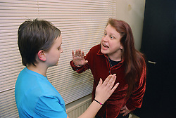 Angry mother shouting at teenage daughter,