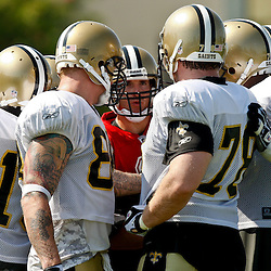 July 31, 2010; Metairie, LA, USA; New Orleans Saints quarterback Drew Brees (9) calls a play from the huddle during a training camp practice at the New Orleans Saints practice facility. Mandatory Credit: Derick E. Hingle