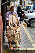 A street vendor sells hand carved wooden kitchen implements in Papantla, Veracruz, Mexico.