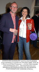 SEBASTIAN SAINSBURY and his wife FILIZIANA  at an exhibition in London on 21st April 2004.PTH 78