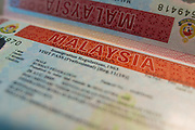 Passport page with Malaysian business visa.