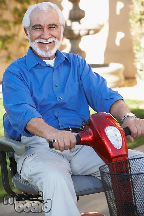 Elderly man on motor scooter