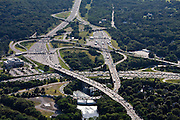 Rush-hour traffic stagnates behind the toll plaza on the Mass Pike, a major east-west toll road. This interchange with the circumferential highway Route 128, lies 10 miles outside of Boston and is a main junction for commuters. Despite numerous lane-widenings, traffic is still bottlenecked at rush hour. The average commute in Massachusetts is 27 minutes.