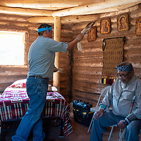 Kevin Begay blesses the Hózhó Sheep Camp hogan in Sheep Springs, on September 21, 2019, as it officially opens for business.