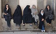 Iranian women wearing at the entrance to the royal palace of Ali Qapu, Isfahan, Iran