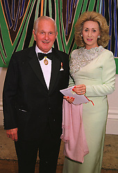 LORD & LADY WOLFSON OF MARYLEBONE, at a dinner in London on 1st June 1999.MSR 39