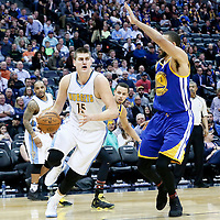 13 February 2017: Denver Nuggets forward Nikola Jokic (15) drives past Golden State Warriors center JaVale McGee (1) during the Denver Nuggets 132-110 victory over the Golden State Warriors, at the Pepsi Center, Denver, Colorado, USA.