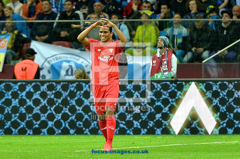 Carlos Bacca of Sevilla celebrates scoring their second goal to make it Dnipro Dnipropetrovsk  1 Sevilla 2 during the UEFA Europa League final at National Stadium, Warsaw<br /> Picture by Ian Wadkins/Focus Images Ltd +44 7877 568959<br /> 27/05/2015