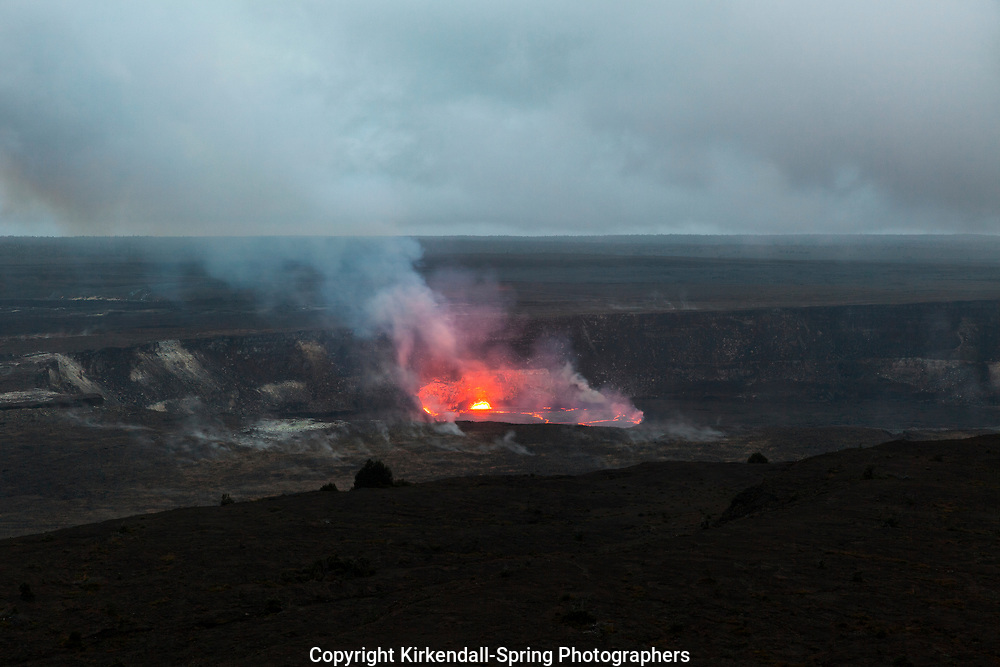 HI00243-00...HAWAI'I - Lava glowing in the Halema'uma'u Crater viewed from the Jaggar Museum in Volcanoes National Park on the island of Hawai'i.