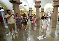 Johnny Seitz (right), 11, of Marion, rubs his foot on the marble compass in the Crypt on a tour of the Capitol from the office of Senator Chuck Grassley in the United States Capitol building in Washington, D.C. on Monday, June 27, 2011. The marble compass, which is right below the Capitol Rotunda, marks the center of Washington, D.C..