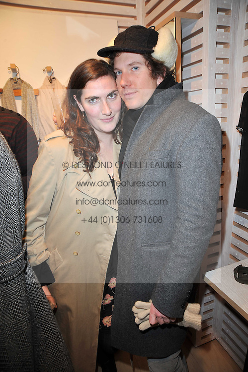 REBECCA GUINNESS and CHRISTOPHER TAYLOR at the launch party for Club Monaco at Browns, 32 South Molton Street, London on 16th February 2011.