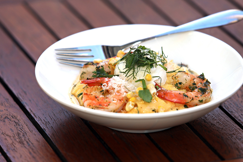 Prawns and polenta--seared shrimp, creamy polenta, poached egg and brown butter. Outside dining at the Upsider, 1004 2nd Ave. (at 53rd Street), Monday, April 6, 2015.