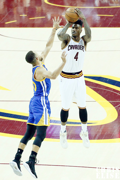 07 June 2017: Cleveland Cavaliers guard Iman Shumpert (4) takes a jump shot over Golden State Warriors guard Stephen Curry (30) during the Golden State Warriors 118-113 victory over the Cleveland Cavaliers, in game 3 of the 2017 NBA Finals, at  the Quicken Loans Arena, Cleveland, Ohio, USA.