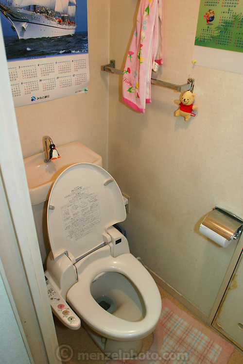 Toilet in an apartment of a young married couple with a small child in Osaka, Japan. The toilet has automatic anal sprinklers and a blow dryer.