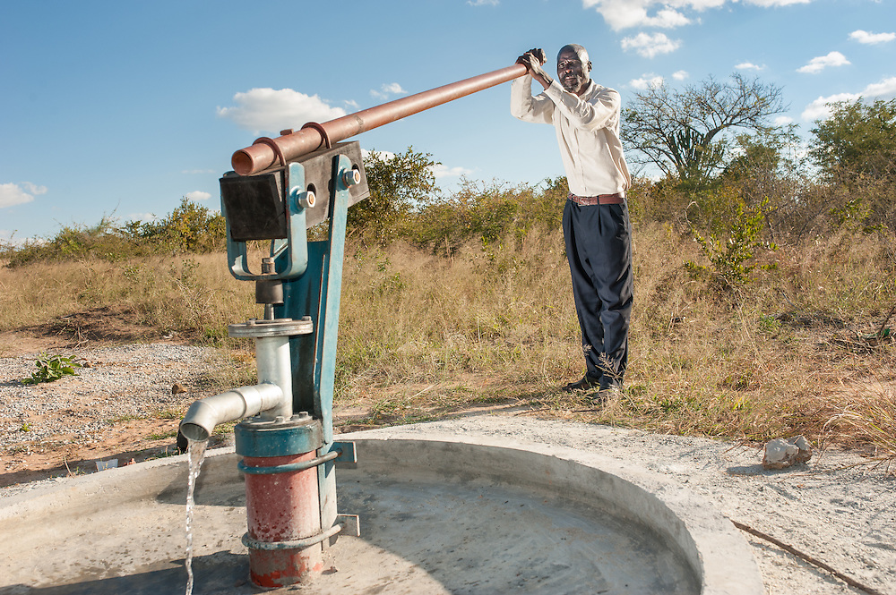 CAPTION: Alfred, Headman of Mawoneke Village, pumps water from one of the newly installed borehole water pumps. LOCATION: Mawoneke Village, Chivi District, Masvingo Province, Zimbabwe. INDIVIDUAL(S) PHOTOGRAPHED: Alfred Mawoneke.