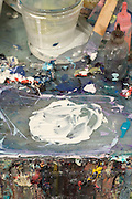 close up of the table with paint in an artist studio