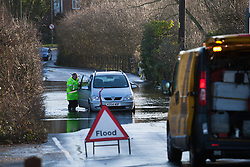 © Licensed to London News Pictures. 01/02/2014. Titchfield, Hampshire, UK. A broken down car being assisted by the AA breakdown service in flood water from the River Meon, which is out of bank in Titchfield, Hampshire. There is wet and windy weather forecast for the UK today, 1st February 2014. Photo credit : Rob Arnold/LNP