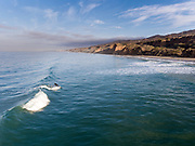 Aerial photo of a surf break in Southern California.