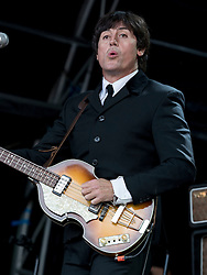 The Bootleg Beatles performing at Party At The Palace Music Festival in Linlithgow Palace grounds on Sat 13th August 2016.<br /> <br /> The Bootleg Beatles are a Beatles tribute band. <br /> <br /> Adam Hastings (John Lennon) – guitar, vocals, keyboard, harmonica<br /> Steve White (Paul McCartney) – bass, vocals, keyboard <br /> Stephen Hill (George Harrison) – guitar, vocals <br /> Gordon Elsmore (Ringo Starr) – drums, percussion, vocals <br /> <br /> Alan Rennie/ EEm