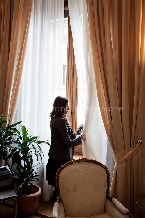 ROME, ITALY - 23 MAY 2013: Ornella Mollica (32), press officer of the new Italian Minister for Integration C&eacute;cile Kyenge, closes the curtain of the minister's office before the photo shoot, in Rome, Italy, on May 23rd 2013. C&eacute;cile Kyenge, Italy's first black minister, proposed the so-called &quot;Ius soli&quot;, a law that would give citizenship to the children of immigrants if they are born on Italian soil.<br /> <br /> Gianni Cipriano for The International Herald Tribune