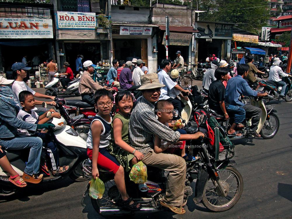 Vietnam, Ho Chi Min City: family on the motorbike.