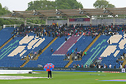 Rain stops play - Spectators huddle under the grandstand roof as rain continues to fall during the ICC Cricket World Cup 2019 match between Afghanistan and Sri Lanka at the Cardiff Wales Stadium at Sophia Gardens, Cardiff, Wales on 4 June 2019.