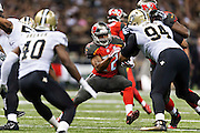 NEW ORLEANS, LA - SEPTEMBER 20:  Doug Martin #22 of the Tampa Bay Buccaneers runs the ball during a game against the New Orleans Saints at Mercedes-Benz Superdome on September 20, 2015 in New Orleans Louisiana.  The Buccaneers defeated the Saints 26-19.  (Photo by Wesley Hitt/Getty Images) *** Local Caption *** Doug Martin