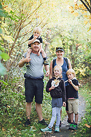 candid family photos of Jess and Adrian in arrowtown hiking in autumn with Lilia, Mitchell and Oswald by felicity jean photography family portrait photographer on the beautiful Coromandel Peninsula natural candid documentary style photos Matarangi Otama Opito Whitianga Hahei