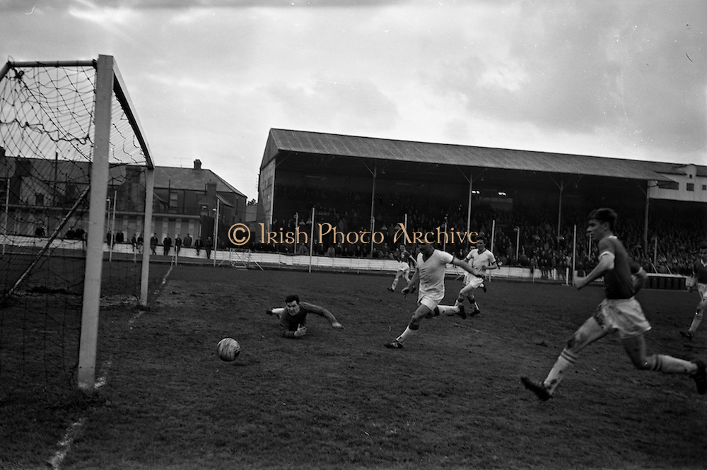 20/03/1963<br /> 03/20/1963<br /> 20 March 1963<br /> Soccer: Transport v Limerick, Cup tie replay at Harold's Cross, Dublin. Transport goalie Grogan, watched as Limerick's first goal is scored by O'Conner (in distance left). Also in the picture is O'Brien, Limerick (on right).