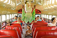 MR. Model relased photo. Group of dancers travel in a Panamenian public bus, known as Diablo Rojo, Red Devil.