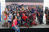 Garden City, New York, U.S. July 20, 2019.  The NY Avengers Cosplay Group, a not-for-profit, and visitors are on stage for photos, during the Moon Fest Apollo at 50 Countdown Celebration happening at Cradle of Aviation Museum in Long Island at the time Apollo 11 Lunar Module, The Eagle, landed on the Moon 50 years ago.
