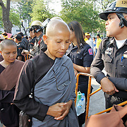 Buddhist nuns arrive at a protest rally in Bangkok, Thailand.
