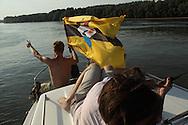 LSA member Yoshi Livo holding the Liberland flag on the Danube
