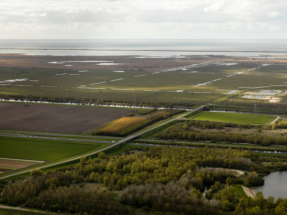 Nederland, Zuidelijk Flevoland, 16-04-2012; file op de A6, Oostvaardersplassen in de achtergrond.Traffic jam, nature reserve Oostvaarderplassen in de achtergrond..luchtfoto (toeslag), aerial photo (additional fee required).foto/photo Siebe Swart