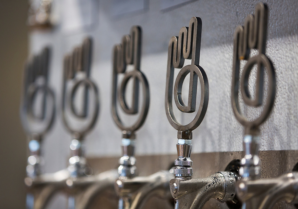 Steel tap handles on display at Working Draft Beer Company in Madison, Wisconsin, Thursday, March 22, 2018.