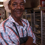 Homeless Soap Kitchen in Atlantic City. Portrait of volunteer preparing food in advance. <br />