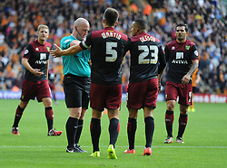 Norwich City's Martin Olsson shove's  Referee Simon Hooper after receiving his second yellow card and being sent off. - Photo mandatory by-line: Alex James/JMP - Mobile: 07966 386802 10/08/2014 - SPORT - FOOTBALL - Wolverhampton - Molineux Stadium - Wolves v Norwich City - Sky Bet Championship