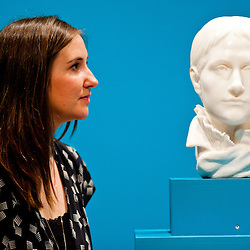 London, UK - 19 June 2013: Hannah Talbot, marketing managar at the Courtauld Gallery, looks at ?Portrait of Mette Gauguin 1879-1880? by Paul Gauguin, one of only two marble   sculptures ever   created by   the   artist.